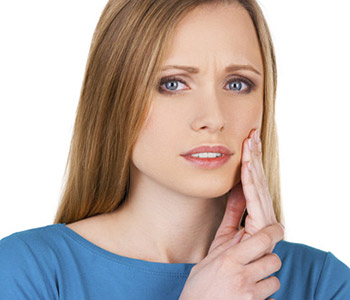 TMJ Disorder Treatment Mayfield Village - Young woman having tooth ache